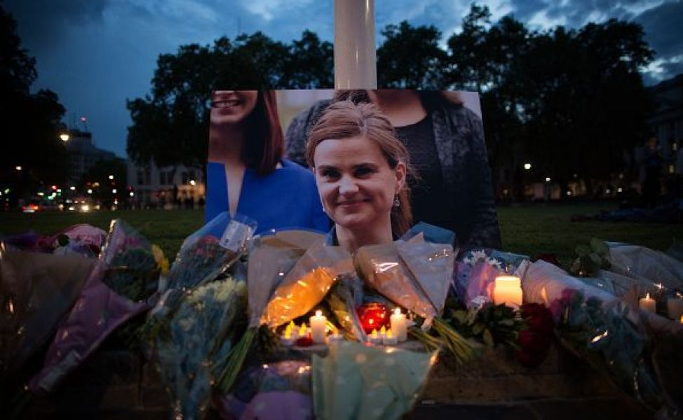 Flowers surround a picture of Jo Cox during a vigil in Parliament Square on June 16, 2016 in London,